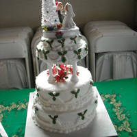 Dec Wedding Bride design. White cake with buttercream frosting. First and last attmept. Too nerve wracking. :)