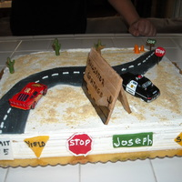 Joey's 1St Birthday Cars Theme Chocolate with butter cream. Everhting but the 2 cars is fondant