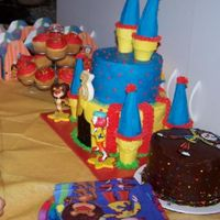 Jojo Cake, Mini Cake, & Cupcakes   Vanilla JoJo castle, chocolate mini cake and vanilla cupcakes.