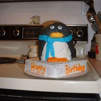 3D Penguin Penguin cake covered in fondant sitting on ice!