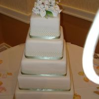 "Stefanie's Wedding Fondant covered - bottom tier is 14"" (280 guests). 5 rows of RI dots and real ribbon at base of each tier. Learned lesson that a..."