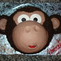 Hannah's Monkey Cake Monkey Cake inspired by several CCer's. 8 inch Round with half sports ball pan for muzzle (which was covered in fondant) Buttercream...