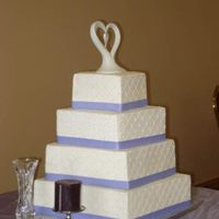 Nicole's Wedding Square cakes, buttercream, diamond imprint sheet, sugar dragess at inersections, real ribbon. This bride was an absolute doll to work with...