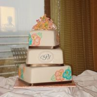 Chantal's Wedding Fondant covered, brushed embroidery hibiscus in coral and teal buttercream (freehanded), real ribbon, gumpaste lilies for topper. ALmond...