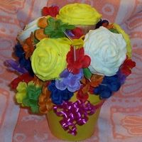 Cupcake Bouquet This is my first attempt at making a cupcake bouquet, Getting the cupcakes to stick and stay on the toothpicks was the biggest challenge....