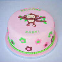 Monkey Girl Cake I made this cake for a friend's baby shower. It was made to match the invitations and room decor. I love the top of the cake but I&#...