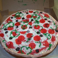 Pizza!! Fun cake made for a little girl's birthday pizza party! Buttercream iced with fondant topping!! The local pizza shop gave me the box!...