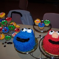 Sesame Street Friends A bunch od sesame street characters for my friend's baby's 1st birthday. Cookie Monster and Elmo done in 8 inch round and all...