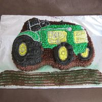 Tractor This cake is chocolate. All decorations are buttercream and chocolate buttercream