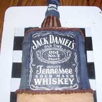 Jack Daniels  This cake was so hard for me to cover in fondant.. It is all vanilla cake with whiskey frosting! Tried to get it to stand up but was...