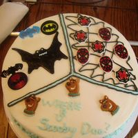 My Four Year Old's First Cake  My son could not make up his mind on what he wanted on his 4th b-day cake. He wanted scoobydoo, batman, and spidey( he calls him that) So...