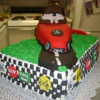 16Th Birthday I made this for my son's 16th birthday. Baked the car cake in a loaf pan and carved it. The driver is made out of gumpaste and fondant...
