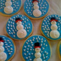 Snowman Cookies These were so much fun to make. All RI with black fondant hats. Thanks for looking!