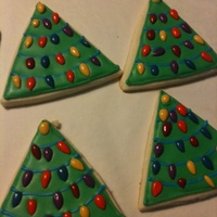 Christmas Trees So Easy! Just used a triangle cookie cutter, flooded the cookie and the lights are actually chocolate-covered sunflower seeds! These were...