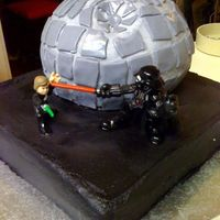Death Star! I made this for my husbands birthday, very happy with the way it turned out. WASC both cakes with Buttercream and MMF accents. Lemon filled...