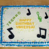 Vanessa's 14Th Birthday Chocolate cake with chocolate mousse filling. Whipped cream icing with buttercream blue borders. Candy clay letters and musical notes.