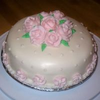 Pink Roses Final cake for Wilton's Class one. Vanilla -cheesecake cake.
