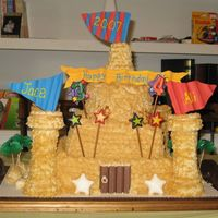 Sandcastle Cake I made this for my niece and nephew's shared b-day party. It was my first attempt with gum paste and my first time doing a really...