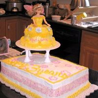 Yellow & Pink Princess Cake This is a two tiered cake -- a sheet cake and a princess cake on top. Madison picked Sleeping Beauty, so we went with a yellow princess...