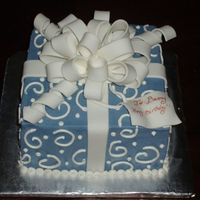 Gift Box  Blue gift box cake covered in buttercream with fondant ribbon and bow. (first fondant bow i've ever made). 3 layer 8 inch square cake...