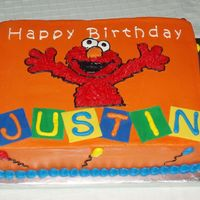 Elmo Birthday   11x15 WASC cake. Orange buttercream icing, fondant blocks. Used my project-a-scope projector to put on the image. My son loved it!