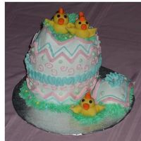 Hatching Chicks   3-D egg cake sitting upright with fondant molded chicks. (WASC with Sharon's buttercream)