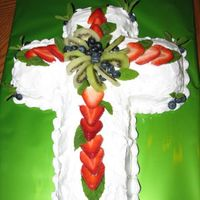 Bountiful Fruit Cross made with Whipped icing, topped with fresh fruit