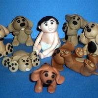 Puppies The little boy and all the puppies are all made from gumpaste