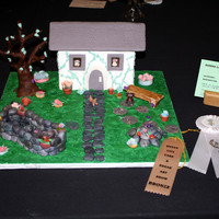 3D Garden Scene Cake This was an entry into my very first cake show and I won 3rd place for it...everthing was created with gumpaste such as the flowers, pond,...