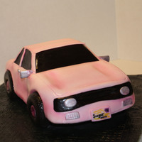 3D Sculpted Car Cake 3D car cake covered in fondant and tehm highlighted with air brushing