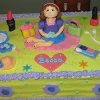 Girly Themed Cake   I used alot of inspiration from many different cakes I found. Color combo was the birthday girls wishes.
