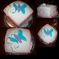 Butterfly Cake This is a layer square yellow cake with buttercream frosting and covered in marshmallow fondant. The butterfly and bow are also made with...