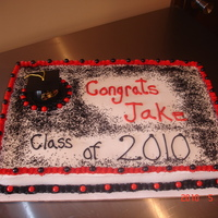Jakes's Graduation Cake White sheet cake with buttercream frosting. Used black glitter on the top. I'm not sure I liked how it turned out but the graduate...