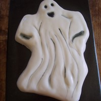 Ghost Made a white cake covered it in white buttercream. Indented the buttercream where the eyes, mouth and ripples belonged, then covered it...