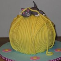 Cat On A Ball Of Yarn This is a cake I made last week for a little girl who loves cats. The cake is covered with strands of marshmallow fondant which dried to...