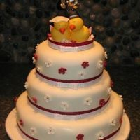 Love Birds This is a cake I made for my cousin's engagement party. The birds and flowers are gum paste.