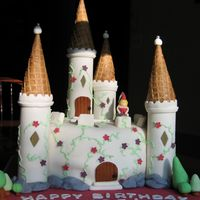 Princess Castle Birthday Cake This is the cake I made for my daughter's 1st birthday. The turrets are made of sugar cones and the towers are dried fondant.
