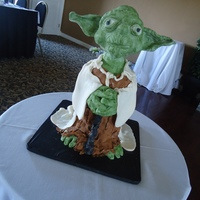 3D Yoda I love making this cake. I made it for a friends grooms!!! Head is a styrofoam ball covered in mmf. ears are gumpaste. Thanks for looking...