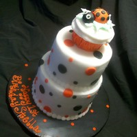 "Mini Lady Bug Birthday Cake And Matching Cupcakes this is a small cake, 4"" and 6"" with a cupcake on top. Buttercream icing with mmf dots and ladybug. Cupcakes are iced with..."