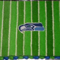 Go Seahawks My son's football team was the Seahawks so this was done for the end of season banquet. BC icing, fondant letters and chocolate...