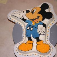 Cub Scout Mickey This was done by my 8 y/o Son for a cub scout project, I gave him very little help, lots of advise and supervision. Chocolate Cake with...