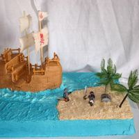 Ahoy Matey's Pick up some great ideas from this site, everyone hear is great. ThanksVanilla cake with BC and MMF. Pirates and chest are a lego toy, Palm...