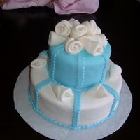 Small Quinceanera Cake Fondant covered cake. From the Wilton course 3.
