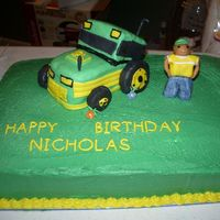 Tractor Cake Cake is covered in buttercream. Tractor is made of cake and covered in marshmallow fondant. The boy is also made out of marshmallow fondant...