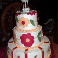 Tiered Baby Shower Cake-Patterned After Baby Bedding Buttercream cake with marshmallow fondant flowers.