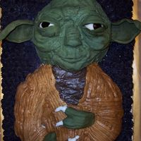 Yoda First attempt at a 3D cake. I started with it upright, then realized there weren't enough dowels in the country to hold him up :) His...