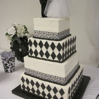 Black & White Wedding Cake All buttercream with chocolate accents and silk ribbon.