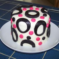 Pink And Black Circle Cake This is the first fondant cake that I have ever made. I haven't taken any classes, but learned how to make this cake by reading...