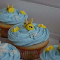 Bumble Bee Cupcakes Made these for my sister's baby shower. The bee's are made out of satin ice fondant. I used an edible black marker for the eye&#...