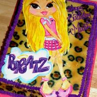 Bratz Cake - Cloe  This is another fondant painting I have done. I airbrished the background like a leopard print and used grass tip 233 for the fuzzy border...